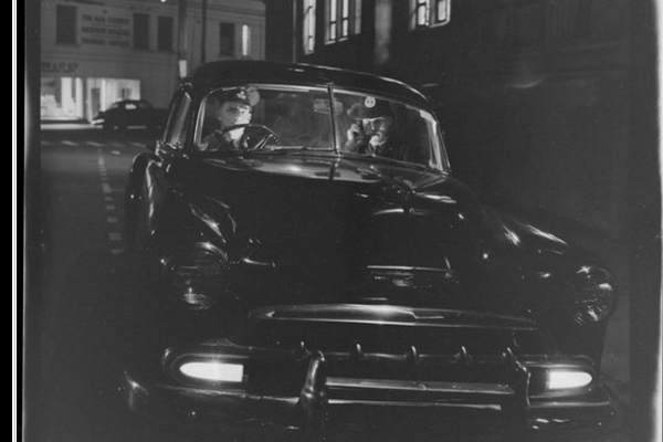 'Police night patrol' (series) with two policeman in black police car. Negatives of the Evening Post newspaper. Ref: EP/1955/1570-F. Alexander Turnbull Library, Wellington, New Zealand. http://natlib.govt.nz/records/23069270