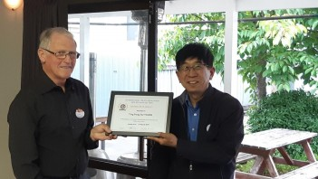 Fong Au Young (right receiving his 40 Year Fidelity Certificate from Les Sharp R3 Chairman)